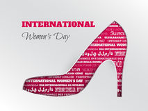 International women`s day greeting card with pink cuted shoe with word cloud in different languages Stock Photos