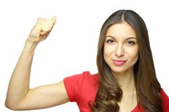 International Women`s Day, March 8. Young woman showing muscles isolated on white background. Strong woman concept. International Women`s Day, March 8. Young Stock Images