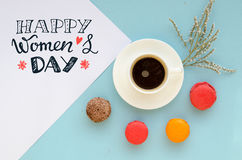 International Women`s Day overhead composition of note with greeting. International Women`s Day vintage overhead composition of note with greeting, macarons and Stock Photos
