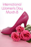 International Womens Day, March 8, ladies pink high heel stiletto shoe and roses Royalty Free Stock Image