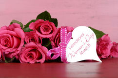International Womens Day, March 8, pink roses with gift tag Stock Image