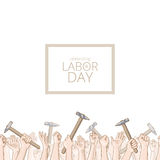 International Workers Day. Hands holding hammers. Vector card with seamless border Stock Images