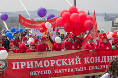 International Workers' Day in Vladivostok. VLADIVOSTOK, RUSSIA - MAY 1, 2015: Citizens and representatives of various organizations take part in May day parade stock image