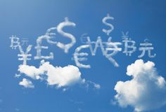 International world Currency cloud symbol. Currency cloud symbol of many country of the world are floating on blue sky royalty free stock image