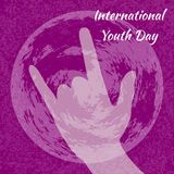 International Youth Day. 12 August. Sign of the horns. Planet Earth. Crimson grunge background. International Youth Day. 12 August. Concept of holiday. Sign of Stock Illustration