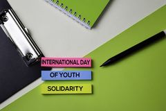 International of Youth Solidarity text on top view office desk table of Business workplace and business objects stock photo