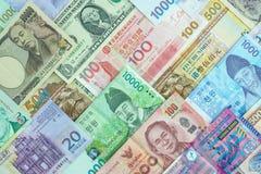 Internationale bankbiljetachtergrond, veelvoudig muntenconcept F stock afbeeldingen