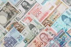 Internationale bankbiljetachtergrond, veelvoudig muntenconcept F stock foto's