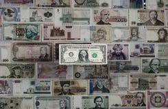 Internationale munt Dollar` s overheersing royalty-vrije stock fotografie