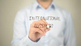 Internationell affär, manhandstil på den genomskinliga skärmen royaltyfria foton