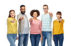 Internationell grupp människor som pekar på dig royaltyfri foto