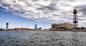Internationell handelmitt och kabelbil i Barcelona, Spanien Arkivfoto