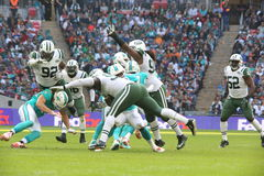 Internationell serielek för New York Jets kontra Miami Dolphins på Wembley Stadium Arkivfoton