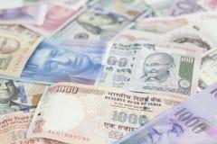 Internationell valutapengarbakgrund arkivbild