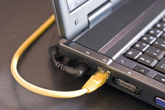 Internet. Laptop cables are connected to the Internet stock photography