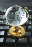 Internet. A earth globe over computer keyboard Royalty Free Stock Photo