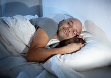 Internet addict man awake late at night in bed sleeping with digital pad or tablet stock photography