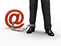 Internet addiction. A person's leg tied to the e-mail sign Stock Images
