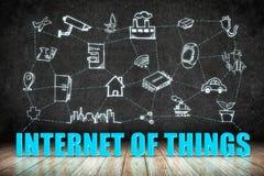 Internet av ordet för saker (IoT) på det wood golvet med klottersymbolen på royaltyfri illustrationer