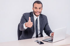 Internet banking for business. Successful African businessman si Stock Photos