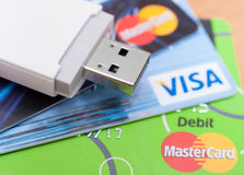 Internet Banking. PRAGUE, CZECH REPUBLIC - AUGUST 7, 2015: Photo of VISA and MasterCard and Mobile Broadband USB Stick royalty free stock image