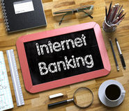 Internet Banking - Text on Small Chalkboard. 3D. Royalty Free Stock Photo