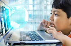 Internet boy. Conceptual image of a boy get amazed with the virtualworld of internet