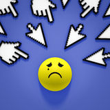 Internet bullying. Hands and arrows cursors pointing at sad face Stock Photo
