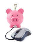 Internet Business. Concept with a mouse and a piggy bank on a white background with focus on the mouse Royalty Free Stock Image