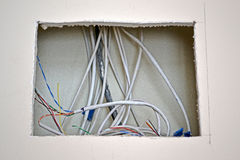 Internet cables heap in square hole under wall, industry details, Royalty Free Stock Photos