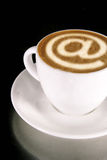 Internet Cafe. A cappucino with latte art at symbol stock photography