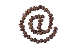 Internet cafe. The @ sign build with coffee beans Stock Photography