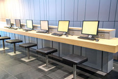 Internet cafe. With row of computers at access point Stock Photography