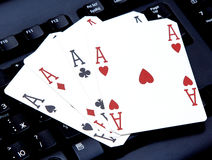 Internet casino poker four of kind aces cards combination hearts Stock Images
