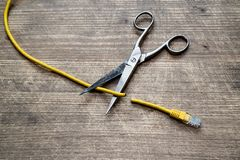 Internet censorship concept. Yellow Internet cable cut by scissors stock image