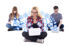 Internet chat concept - two teenage girls and one boy sitting wi Royalty Free Stock Images