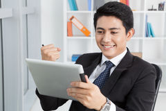 Internet chatting. Happy businessman chatting in the internet using his tablet stock photos