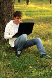Internet chatting in park Royalty Free Stock Image