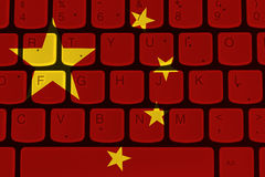 Internet in China, computer keyboard with the Chinese flag. Internet in China, Black and silver computer keyboard with the Chinese flag royalty free stock images