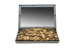 Internet commerce concept with coins and laptop Royalty Free Stock Photography