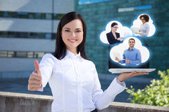 Internet commerce concept - happy business woman with laptop and Stock Photography