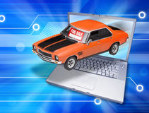Internet Computer Car For Sale. A car coming out of a laptop computer with a for sale sign on the windshield Stock Images
