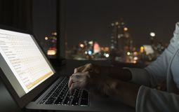 Internet computer network. Internet of things and computer network concept. business women is using laptop computer at office with night city view Royalty Free Stock Photography