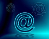 Internet concept. Blue neon at @ e mail sign. made with Photoshop Stock Photography