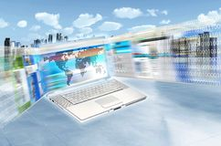Internet & IT Concept. Internet concept illustrated with websites flashing on laptop screen in high speed movement and futuristic cityscape as background Stock Photos