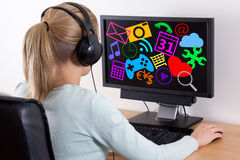 Internet concept - back view of young woman using a computer and Stock Image