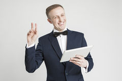 Internet Concept and Ideas. Young Handsome Caucasian Man in Official Suit With Pad Stock Photography