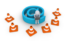 Internet connection is under maintenance by person. Person with laptop sitting on e-mail symbol that is behind traffic cones Royalty Free Stock Image