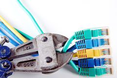 Internet connectors on white background cut with pliers Royalty Free Stock Images