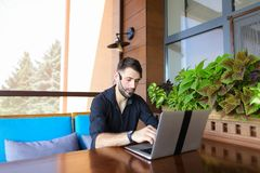 Internet consultant talking to client with web camera and microp. Internet consultant speaking to user with video call and headset microphone. Assured handsome Stock Photo